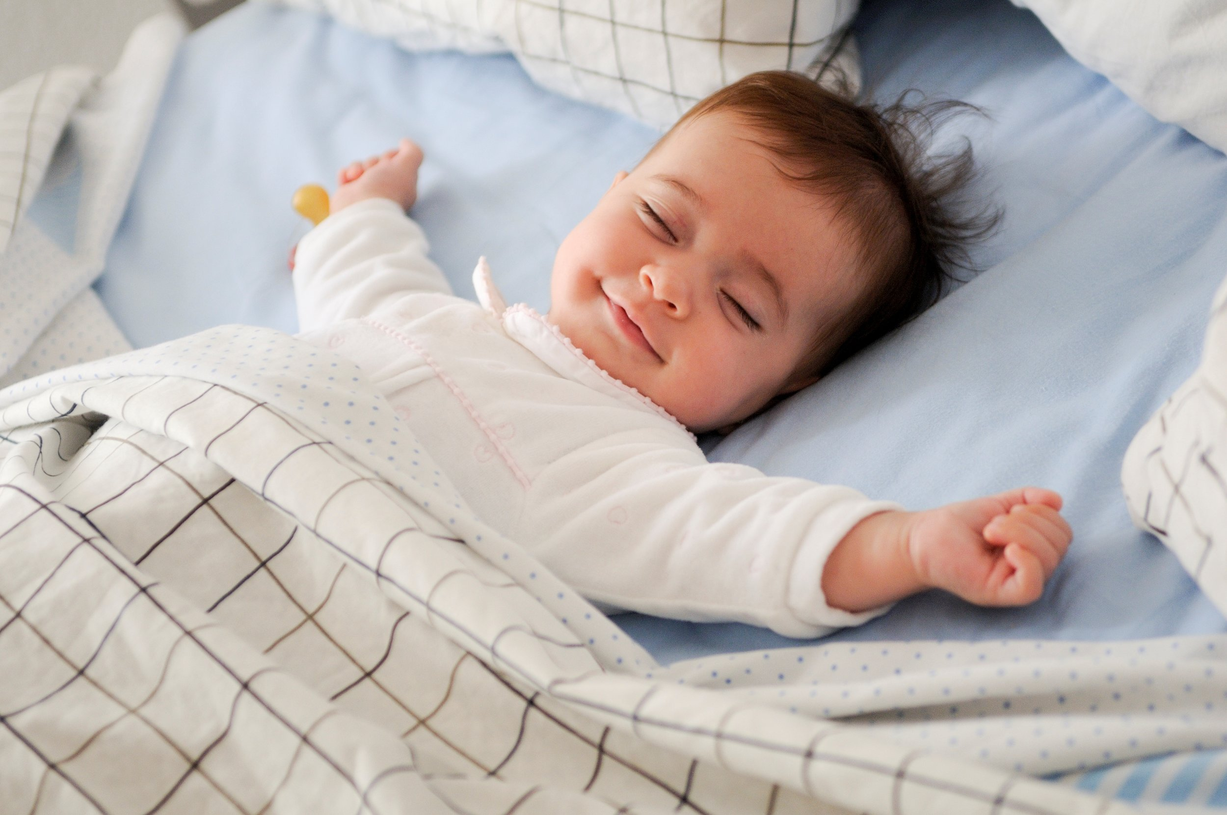 Young child sleeping in bed. Sleep can help fix the blood-brain barrier when it becomes leaky.
