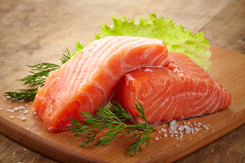 Two pieces of uncooked salmon. Salmon contains omega-3 fatty acids, which have been shown to stimulate the vagus nerve.