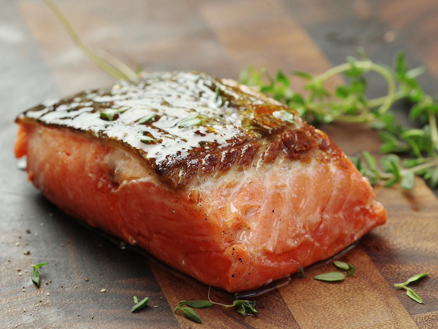 A piece of cooked salmon. Salmon contains omega-3 fatty acids which can help the brain heal and recover from damage.