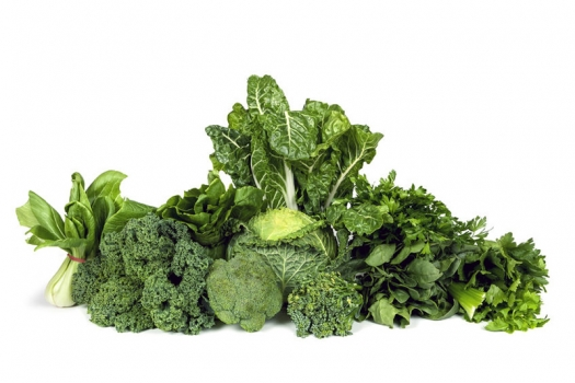 A pile of green, leafy vegetables. They contain folate, a key nutrient involved in lowering and normalizing homocysteine levels.