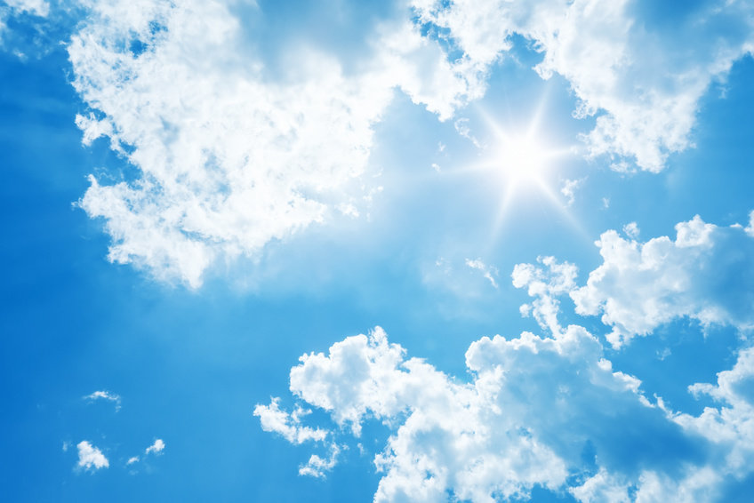 A picture of the sun shining through the clouds around it. Sunlight can increase blood flow to the brain.