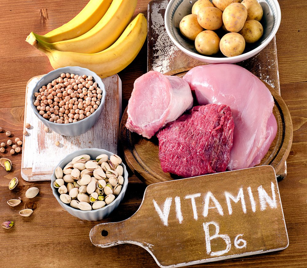 Foods on a table that contain Vitamin B6, including pistachios, chicken, beef, bananas, potatoes, etc. A deficiency in Vitamin B6 can make anxiety worse and make you more anxious.