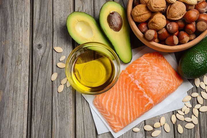 Salmon, avocados, olive oil, nuts and seeds on a picnic table. Salmon is a rich source of omega-3 fatty acids. A deficiency in omega-3 fatty acids can make you more anxious.