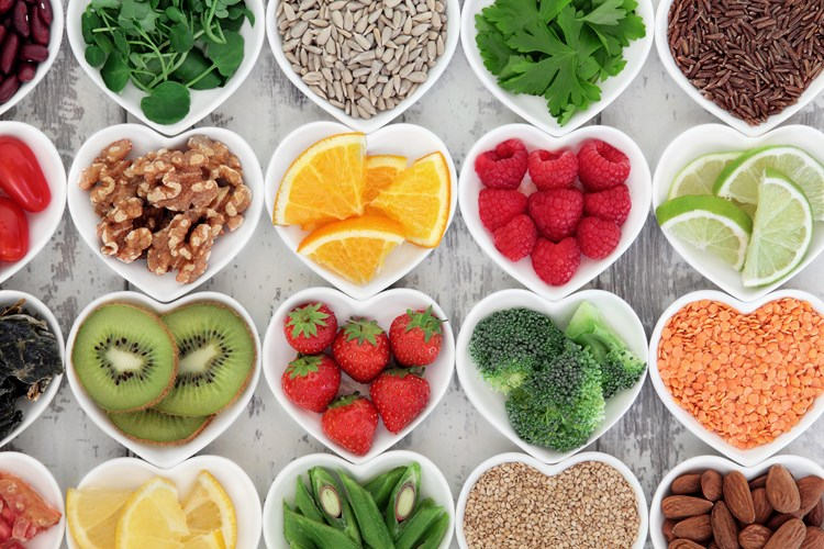 A bunch of antioxidant-rich fruits and vegetables in heart-shaped bowls. Antioxidants can helps the brain form new synaptic connections.