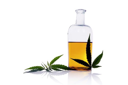 A glass of CBD oil. CDB oil has been shown to help reduce anxiety and stress.