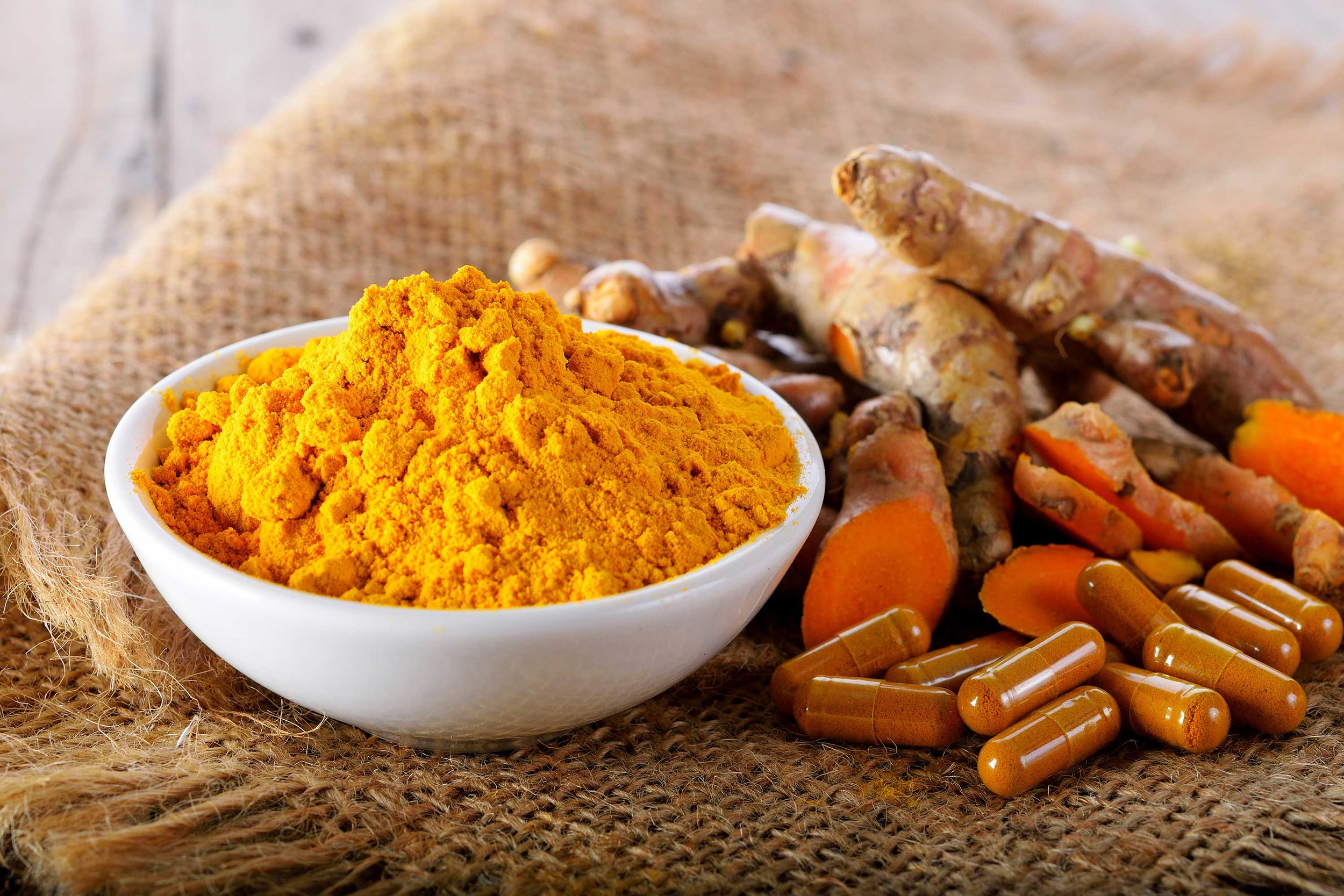 A bowl or turmeric spice. Curcumin is the main compound in turmeric that has been shown to reduce stress and anxiety.