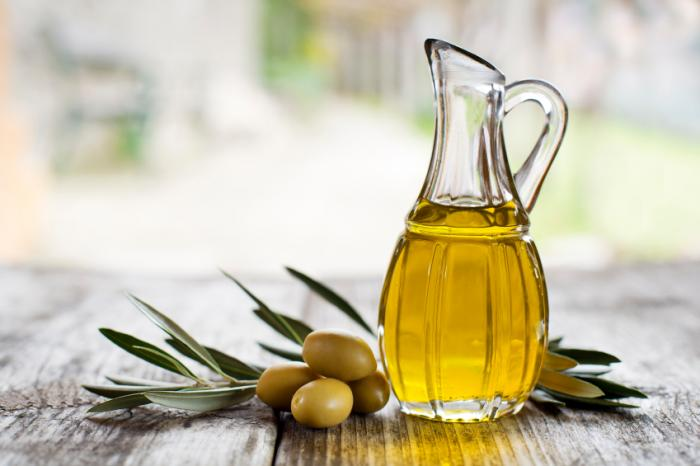 Olive oil on a picnic table. The antioxidants in olive oil can induce autophagy in the brain.