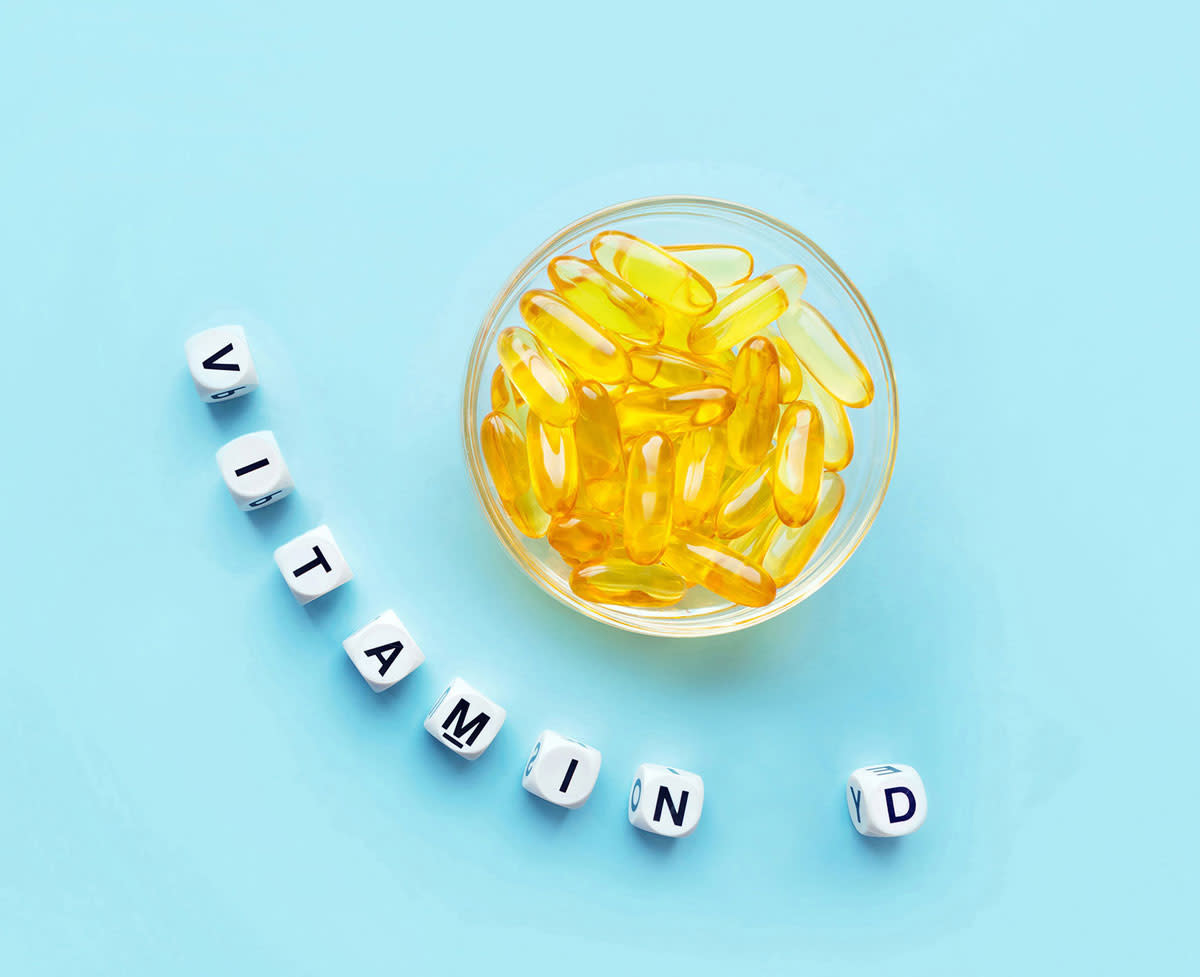 Vitamin D capsules in a clear bowl. Vitamin D supplements can increase IGF-1 levels, especially if you're deficient.