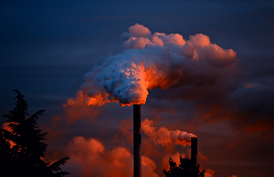 Factory emitting particulate matter and pollution, which can affect brain health.