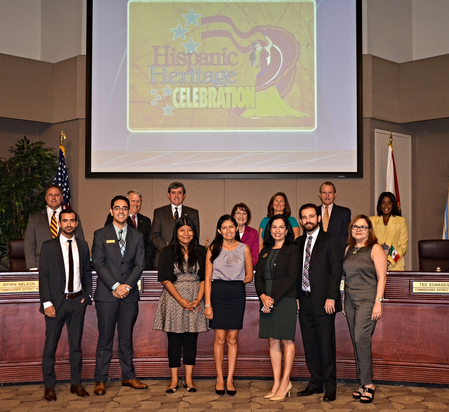 Pictured above-Top Row: District 1 Commissioner Scott Boyd,District 2 Commissioner Bryan Nelson, District 3 Commissioner Pete Clarke,Orange County Mayor Teresa Jacobs, District 4 Commissioner Jennifer Thompson, District 5 Commissioner Ted Edwards, District 6 commissioner Victoria Siplin.   Bottom Row: Gonzalo Loayza, Kevin Ortiz, Bernarda Garcia, Karol Haugan, Maritza Martinez, Omar Cardona-Sanchez, Nancy Sharifi