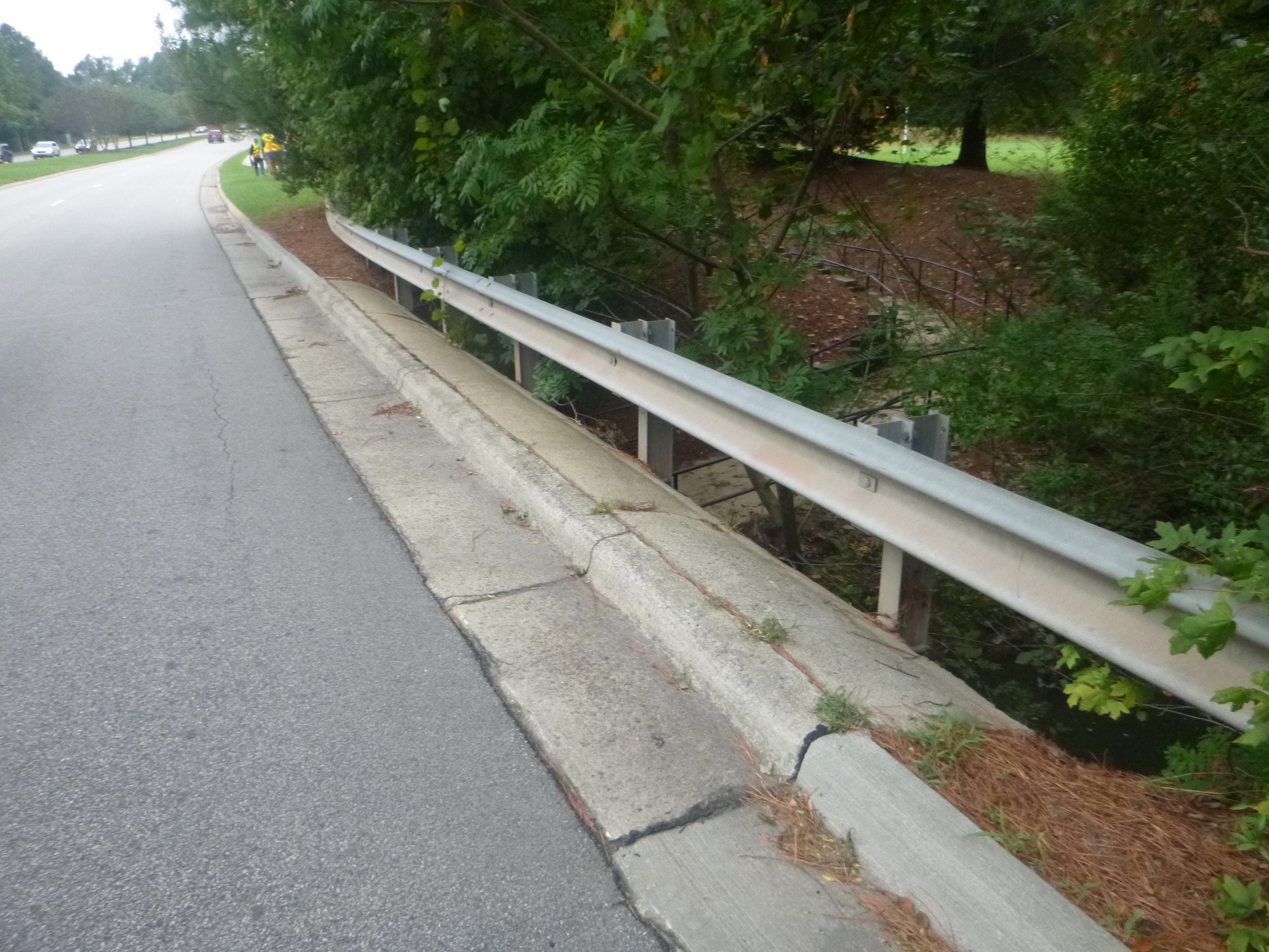 The new bridge will cross Crabtree Creek and connect sidewalks on this side of Cary Parkway.