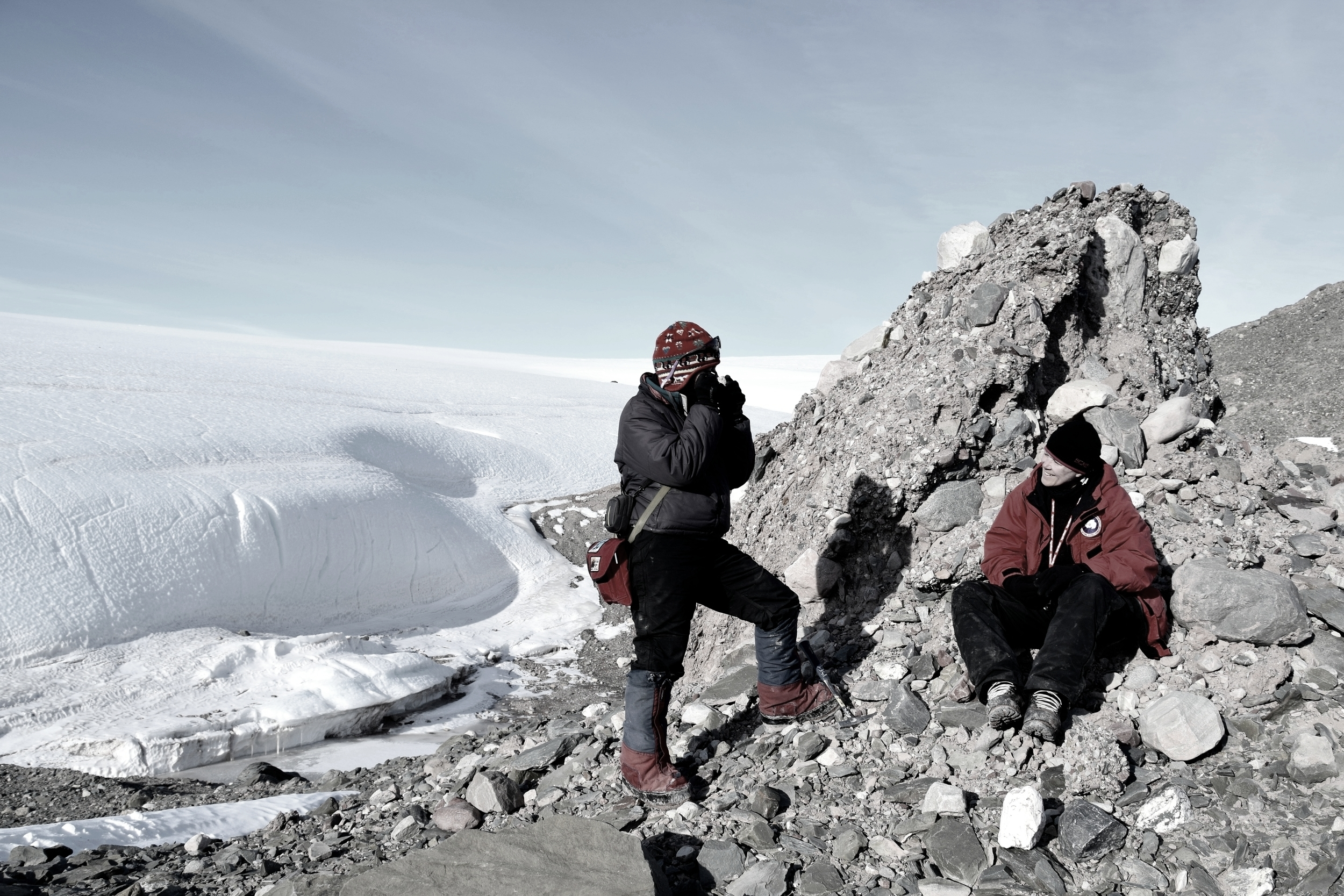 Geologist Sidney Hemming and a colleague from Lamont-Doherty Earth Observatory are shown examining glacial debris along the edge of Antarctica's Foundation Ice Stream.  They're studying how ice sheets in this area respond to changing climate //photo. Trevor Williams
