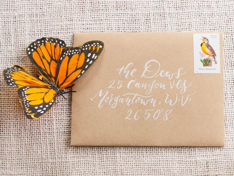 wedding envelope calligraphy simple white on kraft envelope