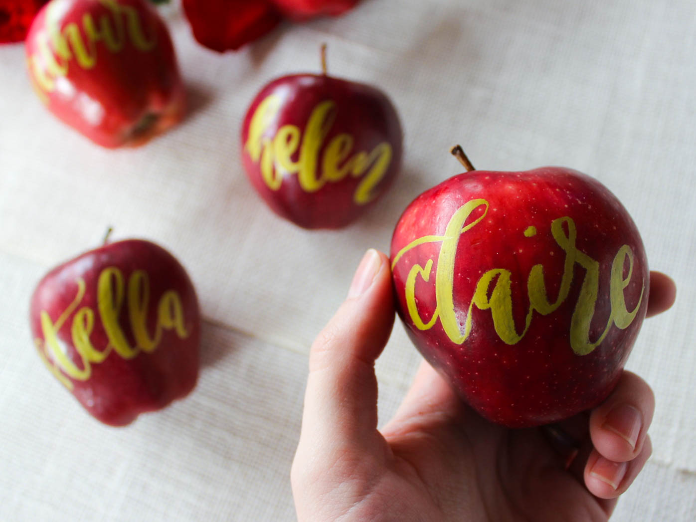 gold calligraphy on apples
