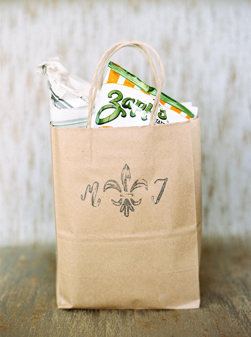 custom stamped fleur de lis welcome gift bag