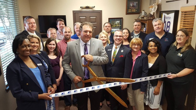 Todd at his ribbon cutting for his Mansfield, Texas office.