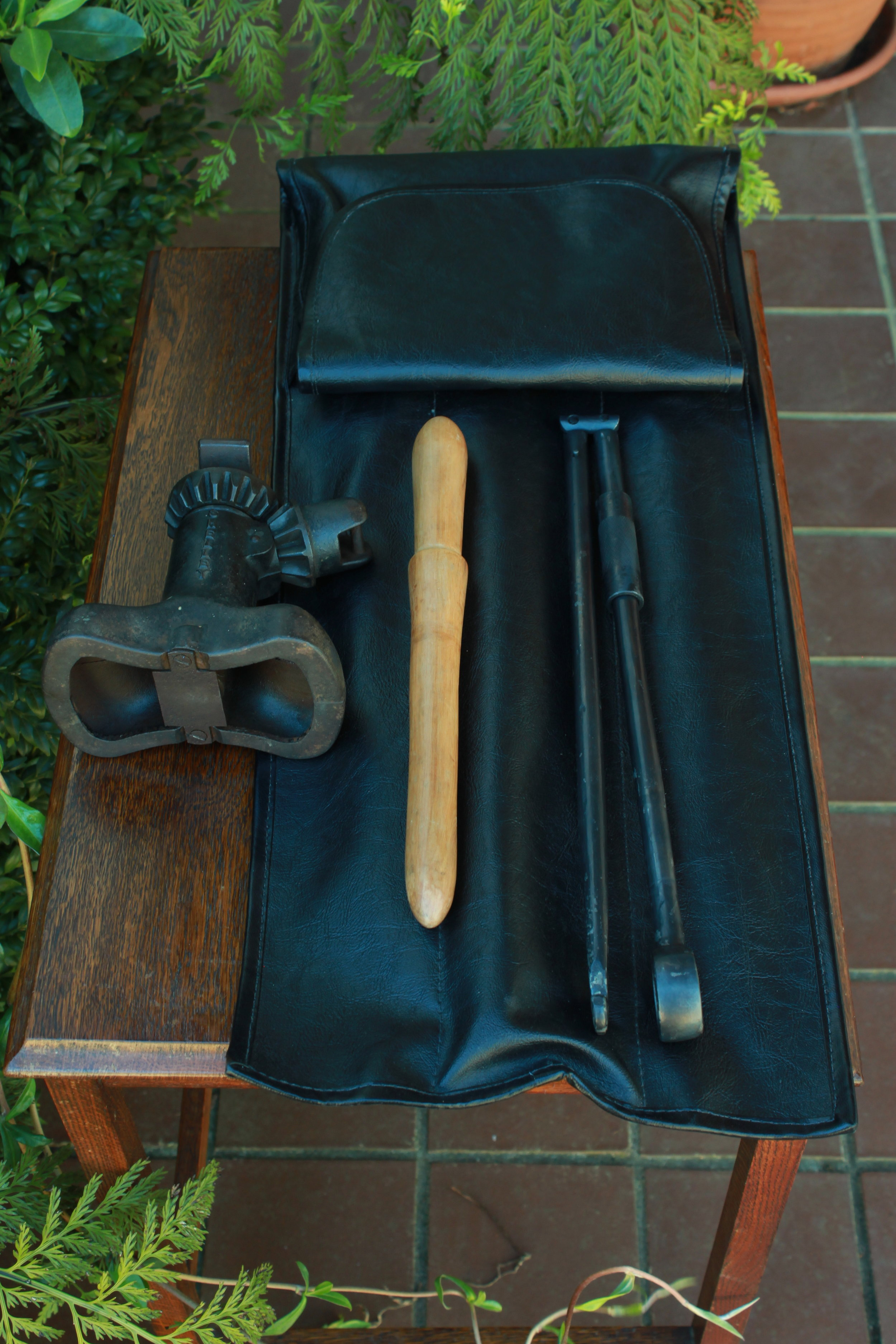 "PRE-WAR MG WHEEL JACK, HANDLE, AND ROLL   Tool kit prepared for concours car show  Pre-war Shelley 6""DL Jack and handle  Serviced jack  Fabricated wooden handle grip, hand forged and machined hook type handle. Forging by Te Kowhai Forge.   Designed and fabricated tool roll for jack and tyre pump"