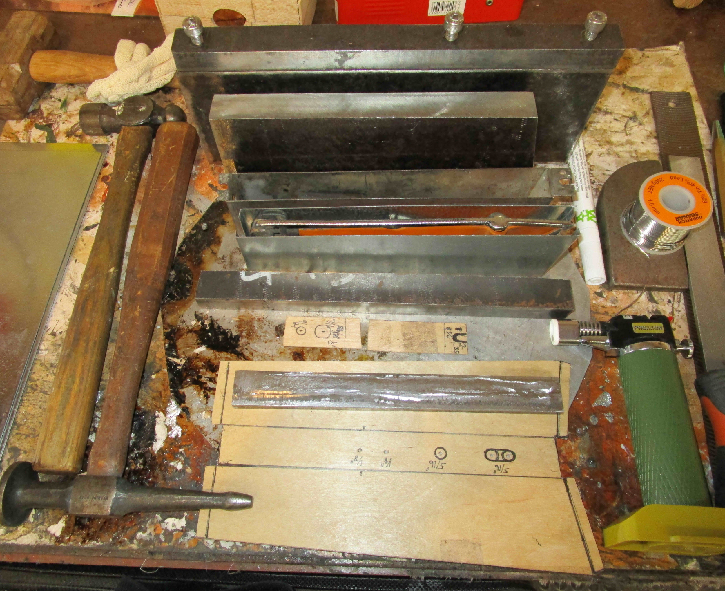 Folding blocks for tin plate, patterns, and panel-making tools.