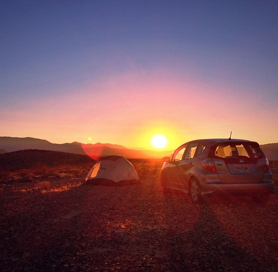 NEVADA - First experience with free camping on BLM land. I pitched my tent facing away from the setting sun, and woke up to watch the sun climb up and over the canyon below me.