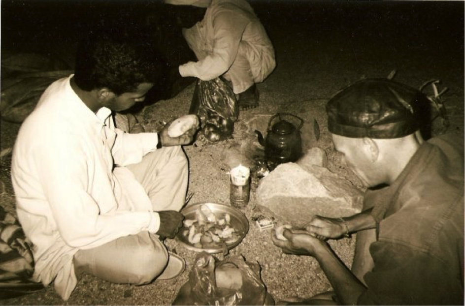 EGYPT -Preparing a meal at night in the Sinai Desert. 2001