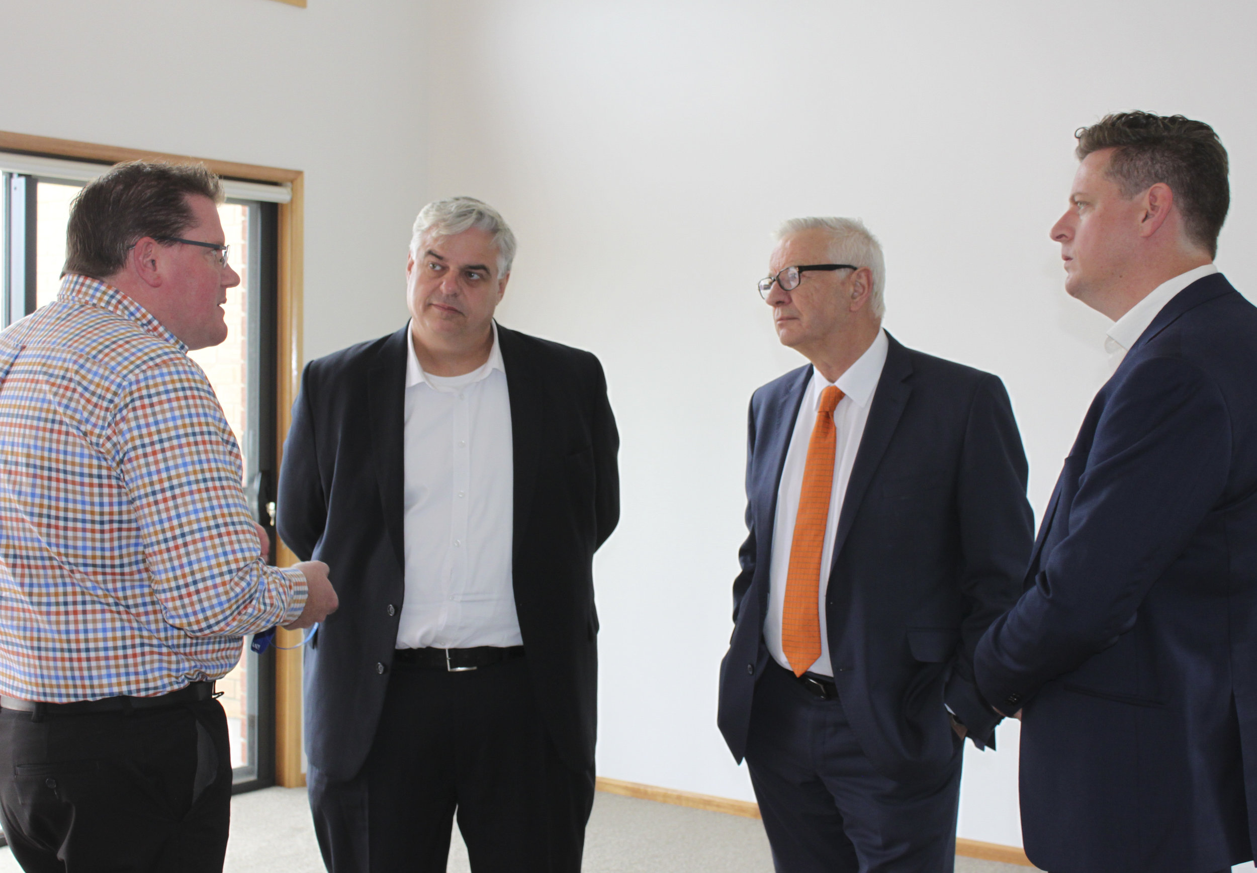 L-R: CatholicCare Director of Housing Services Ben Wilson showing MP for Lyons Brian Mitchell, Senator Doug Cameron and Labor candidate for Clark Ben McGregor through on one of the newly completed units in Green Point Rd.