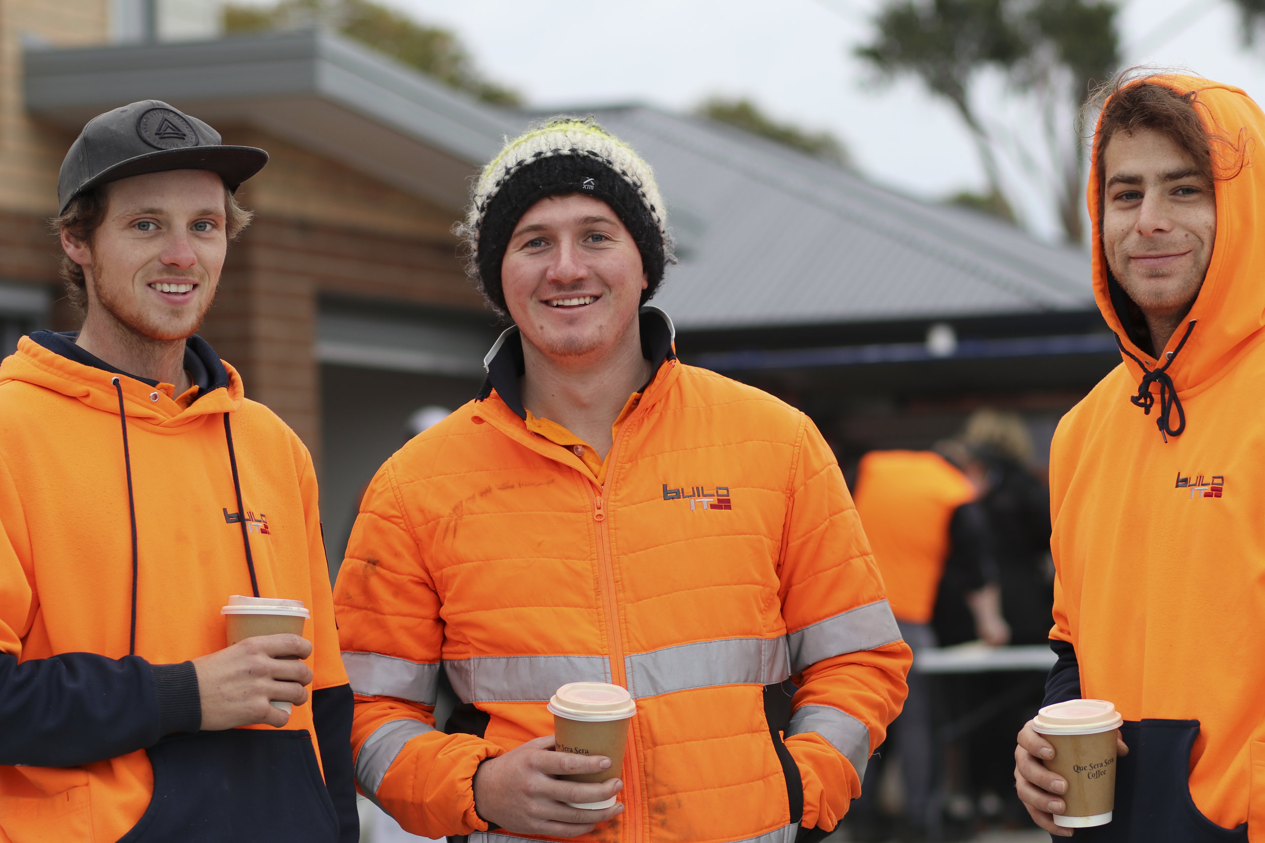 Tradies enjoying breakfast at the Gage Rd building site
