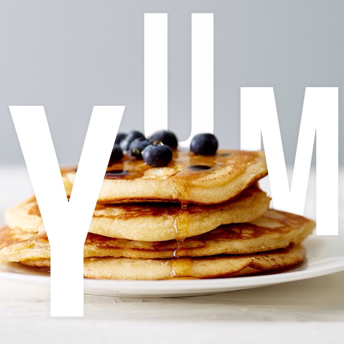 YUM PANCAKES - Social media photography with integrated text for the NOBLE Instagram posted on pancake day.