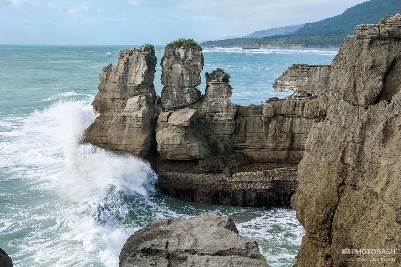 Eroded-Coastline-Cliff-Rocks-Waves.jpg