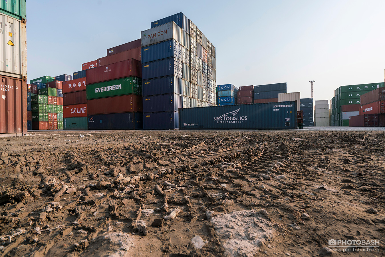 Shipping-Containers-Muddy-Ground.jpg