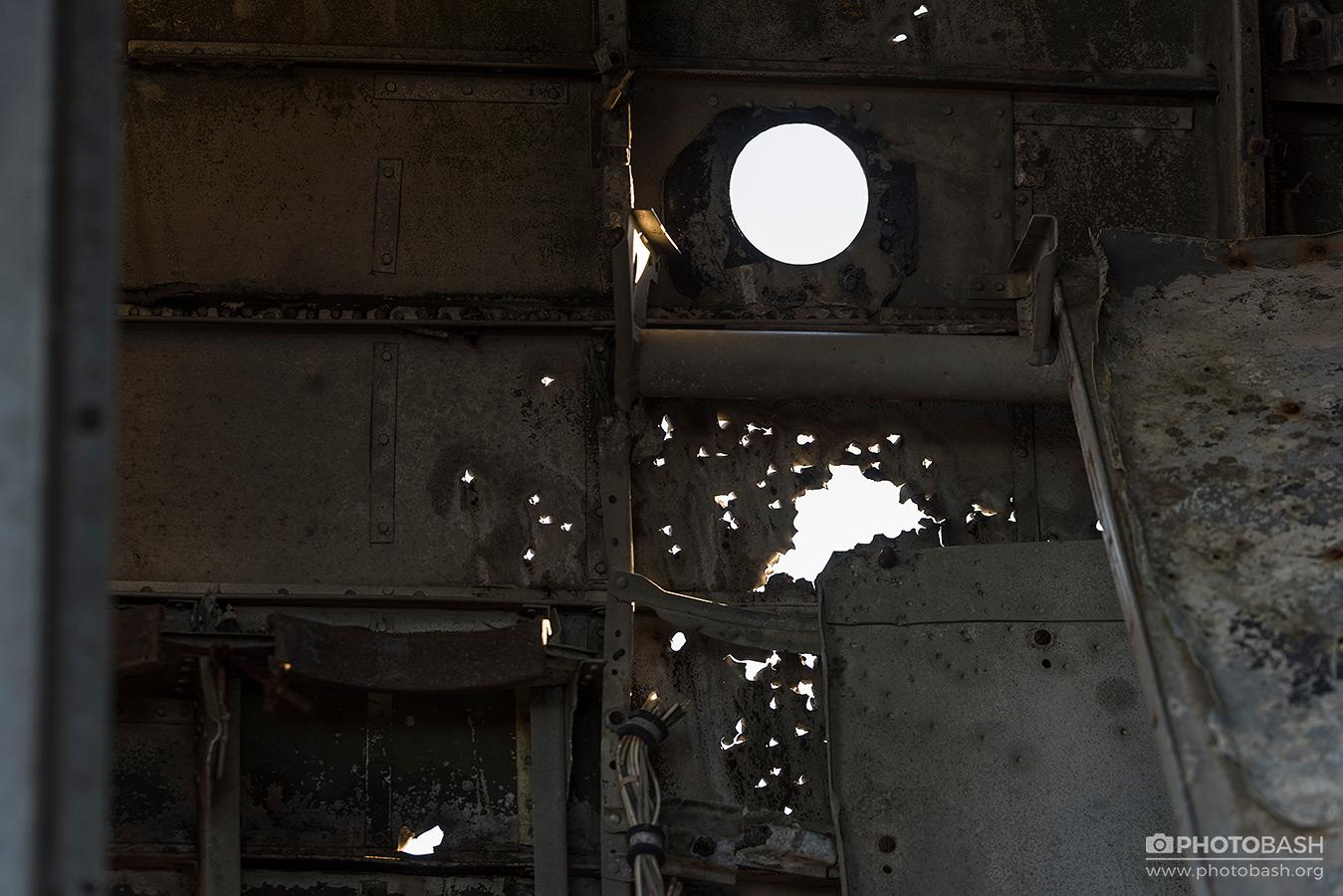 Wrecked-Plane-Metal-Bullet-Holes.jpg