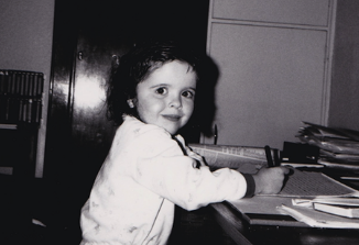 At my dad's desk aged 3