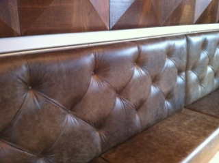green leather banquette seatin.JPG