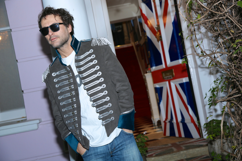 3.Campaign Jimmy Union Jack door  teal jacket.jpg