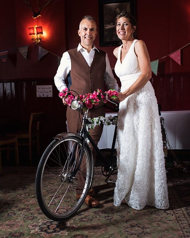 One year ago today we had the joy of photographing Jenn & Ian's big day, which began in Southwark Register Office and turned into a party in East Dulwich Tavern, after the newlyweds and their guests took a short ride on an old Routemaster bus.  Their reception was beautifully decorated with flowers, bunting and their vintage tandem bike, to recognise the couple's love of cycling. There was also a cameo from a jar of Vegemite, as Jenn and her family are from Australia and many had flown over for the day.  The dancefloor was full all night with the couple being keen music enthusiasts - in fact our original connection came from meeting at gigs over the years!  Happy anniversary Jenn & Ian! We hope you've had a fantastic day.