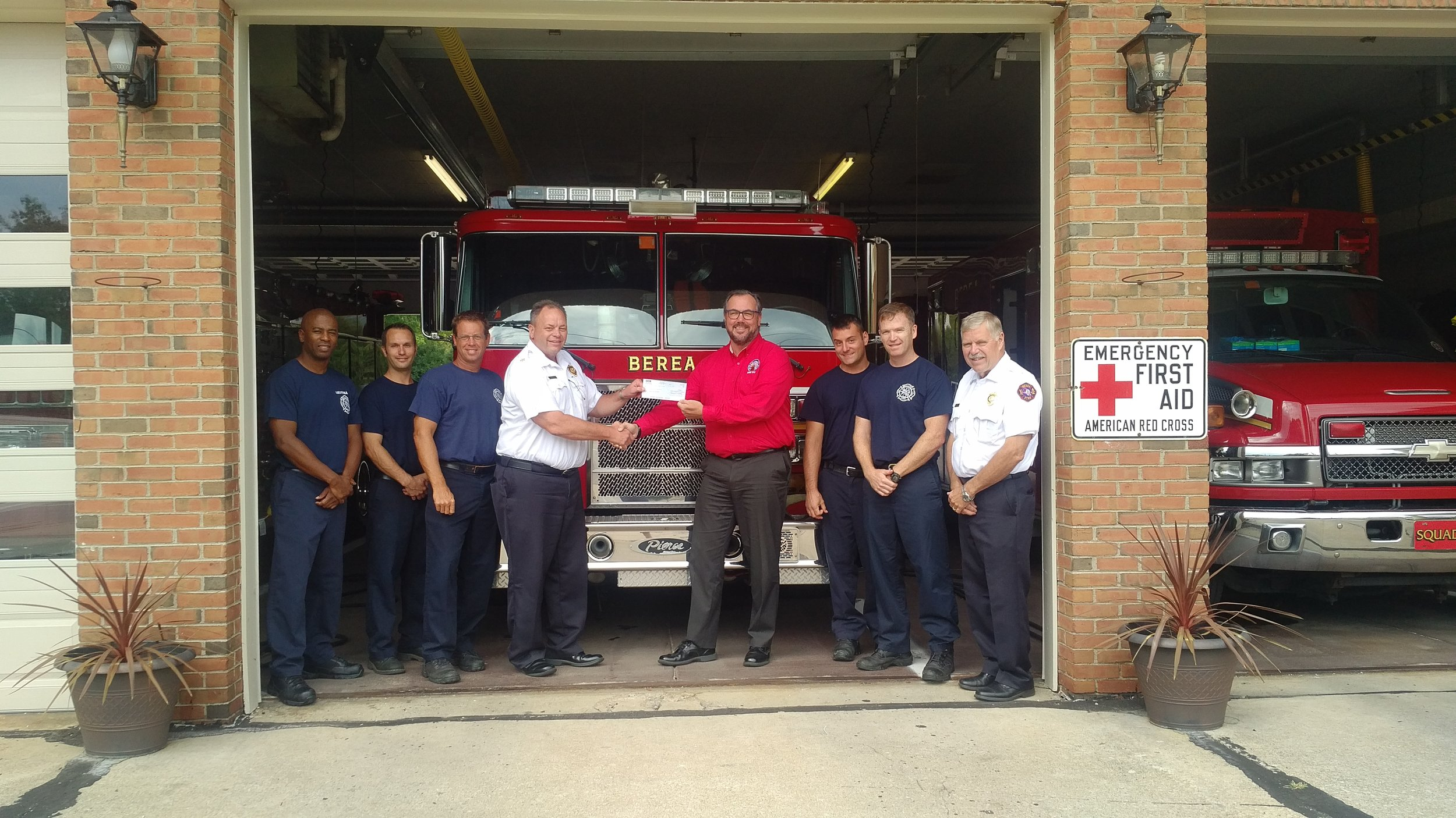 Pictured from left to right, Lt. Williams Phelps, Sr. Firefighter Adam Labuda, Sr. Firefighter Jon West, Chief Mark Kaufhold, Exalted Ruler Richard Threadgill, Sr. Firefighter Mike Kubec, Sr. Firefighter Pat McCarthy, Lt. Tom Emling—Fire Marshall.