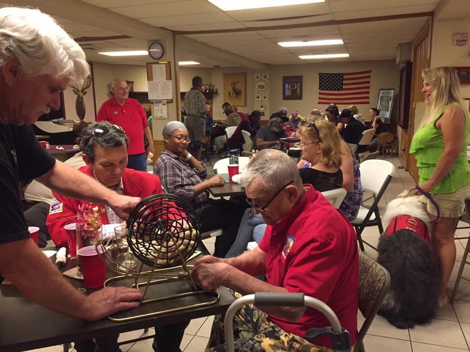 PER Bob Atkinson draws bingo numbers during the vets dinner.