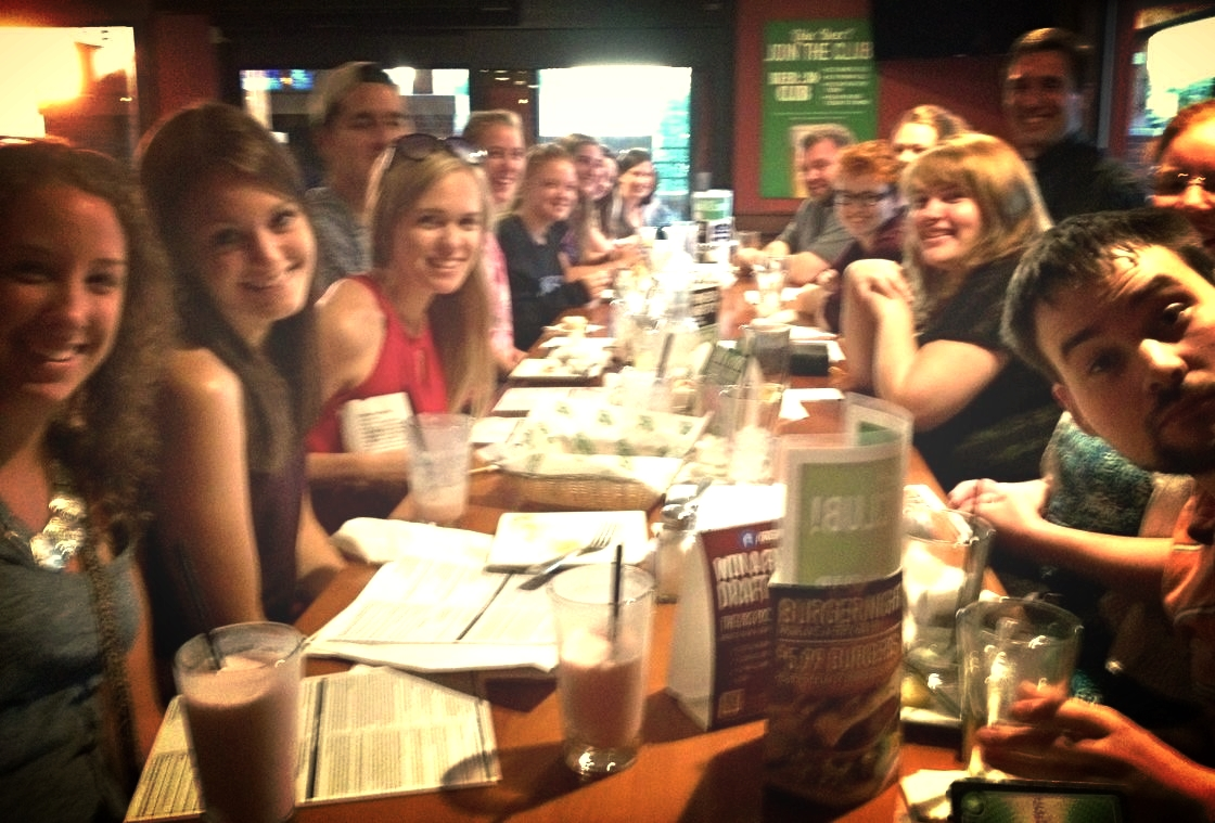 """Fr. Craig Timmerman at Green Mill with young adults at """"Truth on Tap"""" in New Ulm."""