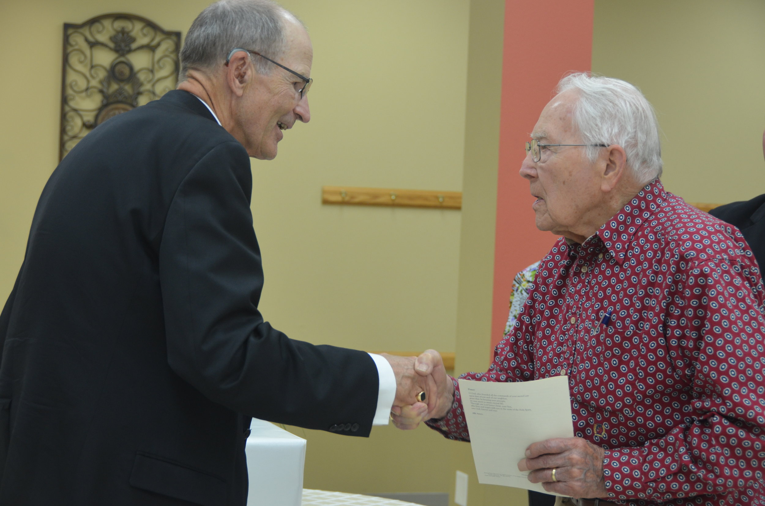 OLIVIA - Bishop LeVoir greets Bob Brix, a parishioner of St. Clara's in Clara City who attended the Sunday, Sept. 23 evening prayer service and reception at St. Aloysius in Olivia in honor of Bishop LeVoir's 10 year anniversary as shepherd of the diocese.