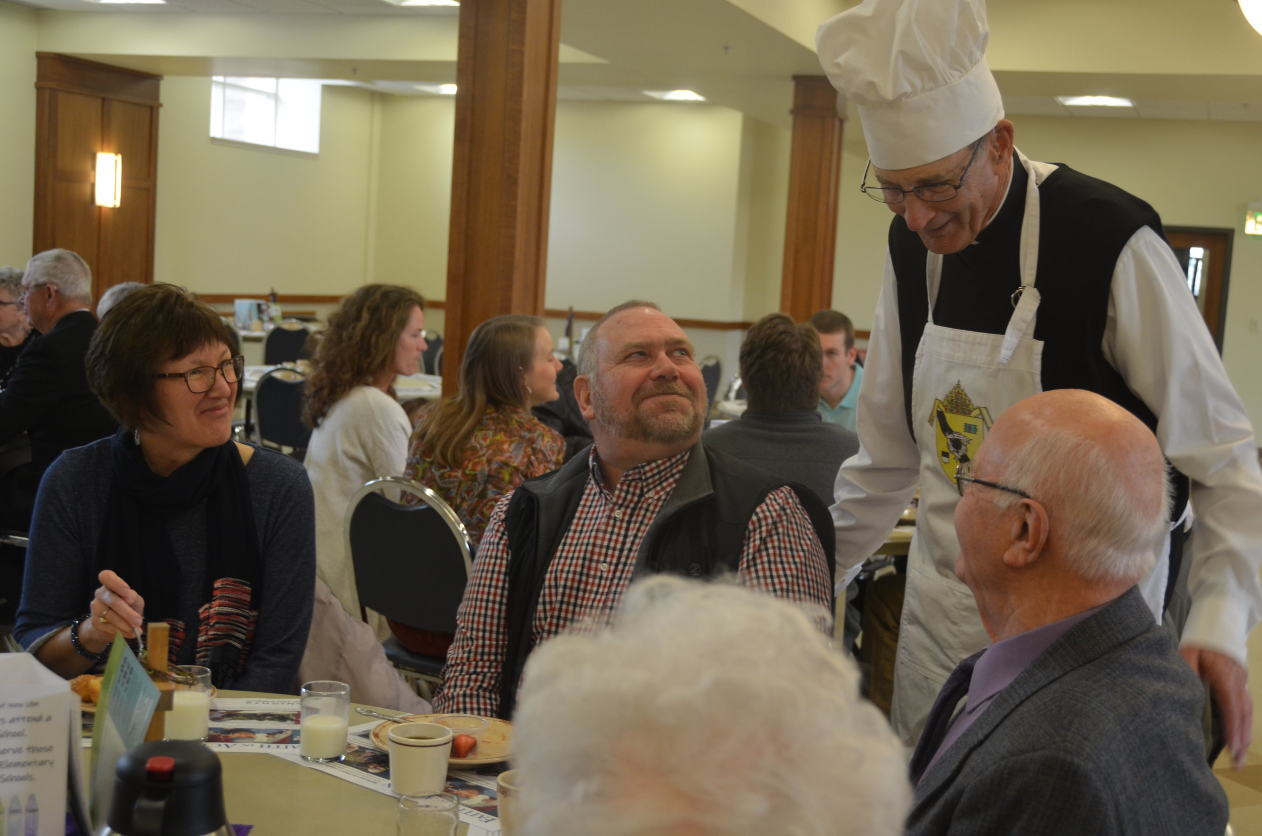 BRUNCH WITH THE BISHOP! - People gathered for brunch on Sunday, March 24 following Mass at the Church of the Holy Redeemer in Marshall for the 5th annual Diocese of New Ulm Brunch with the Bishop. All proceeds from the event support Catholic schools in the diocese.
