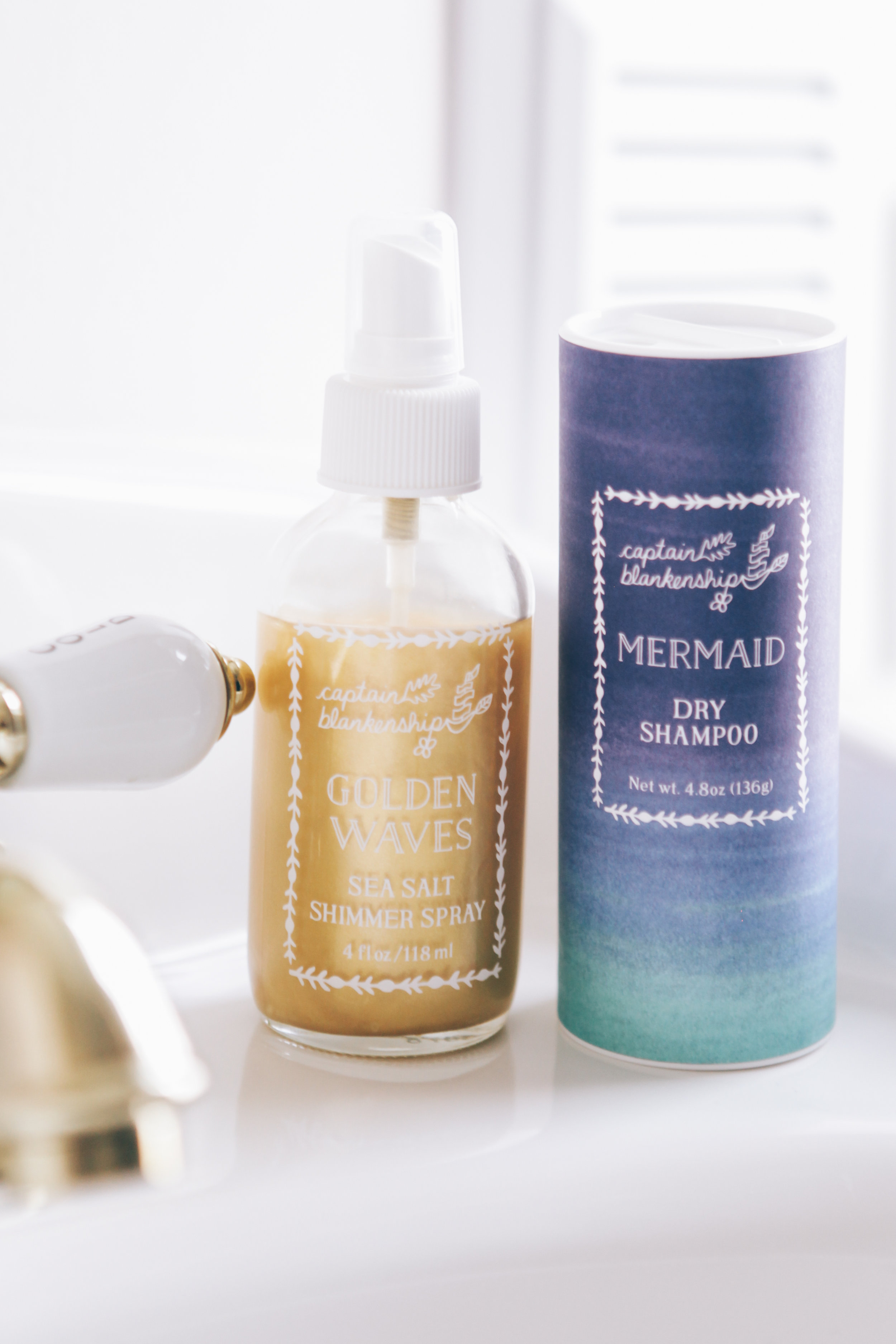 (L to R) Captain Blankenship Golden Waves Sea Salt Shimmer Spray; Captain Blankenship Mermaid Dry Shampoo