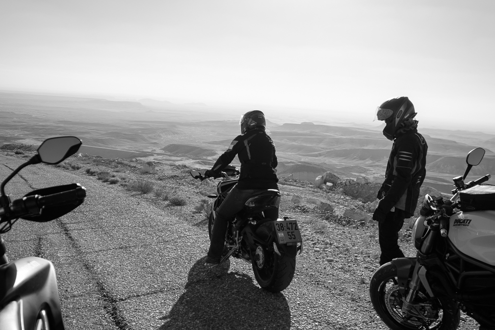 At the second to last rest stop before we take off again with the crew. I stayed behind a little longer to soak in this magnificent moment. Silence. Solitude. I felt at peace. I took one last breathe with my fellow rider, Omri,  and we fastened our helmets and road off into the sunset.
