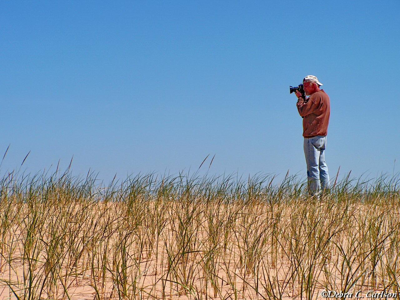 Mark-photographing-at-Sleeping-Bear-Dunes-©Debra L. Carlson.JPG