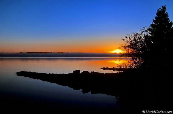 Sunrise over Potagannissing Bay; ©markscarlson.com