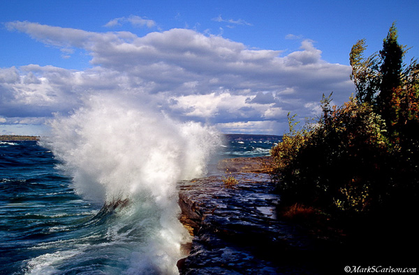 Lake Superior wave crashing into rocky shore; ©markscarlson.com