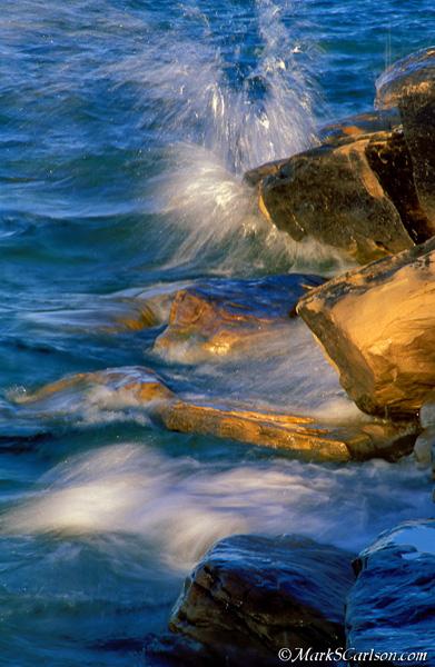 Lake Superior waves splashing sandstone shoreline; ©markscarlson.com