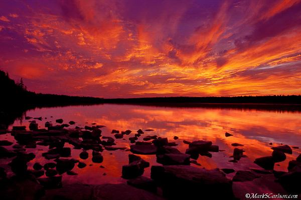 Twilight clouds, reflecting in Cypress Lake, Canada; ©markscarlson.com