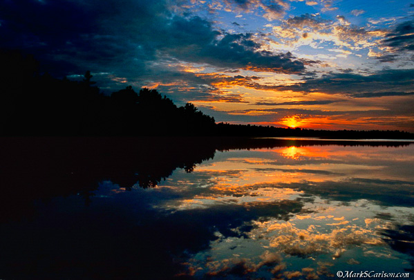 Dramatic clouds and sunset over Lake Stella; ©markscarlson.com