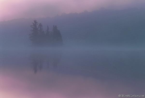 Island on foggy lake at dawn; ©markscarlson.com