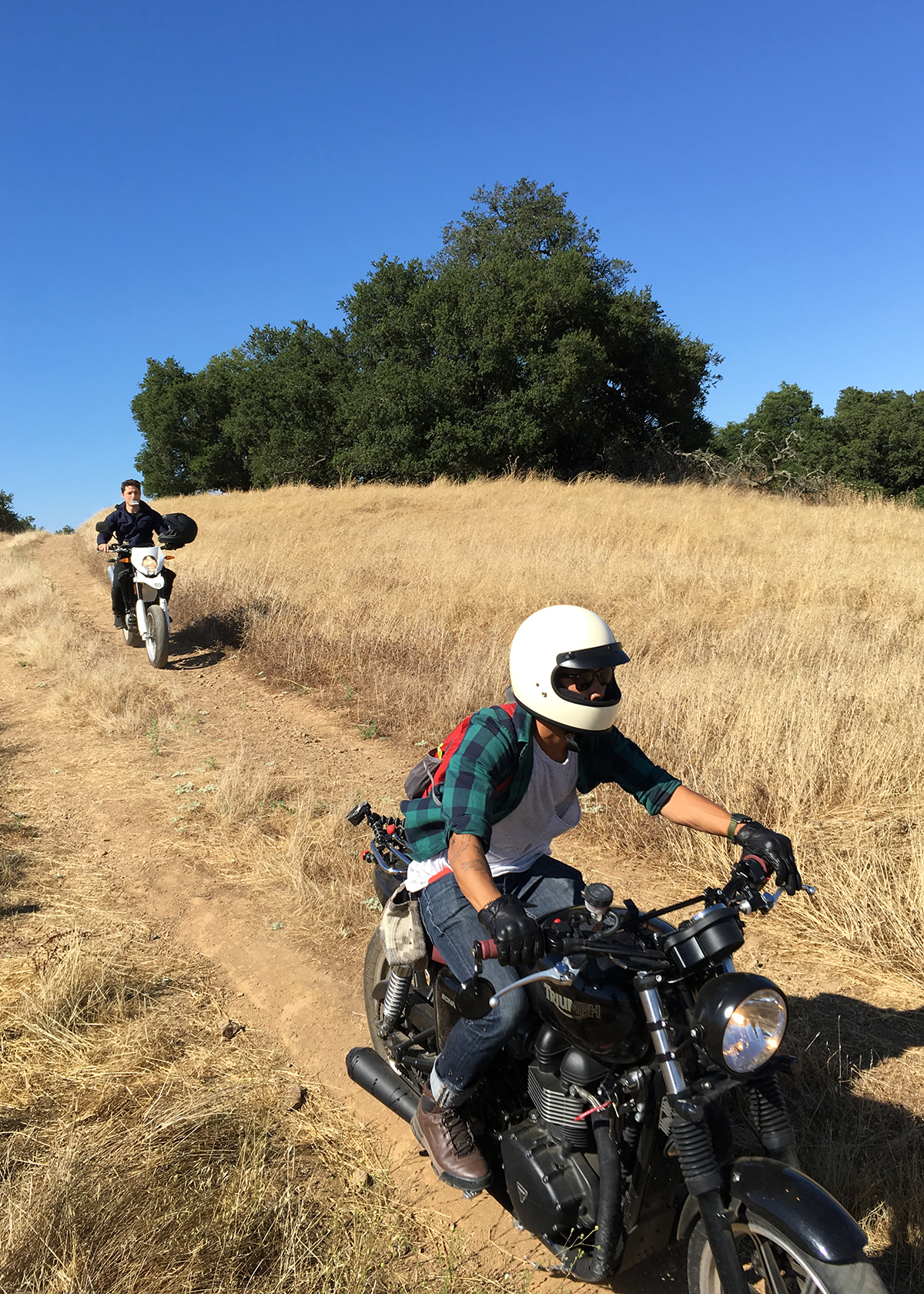 Martin Gschwandtl, and Hoang M Nguyen riding motorcycles in california back country.