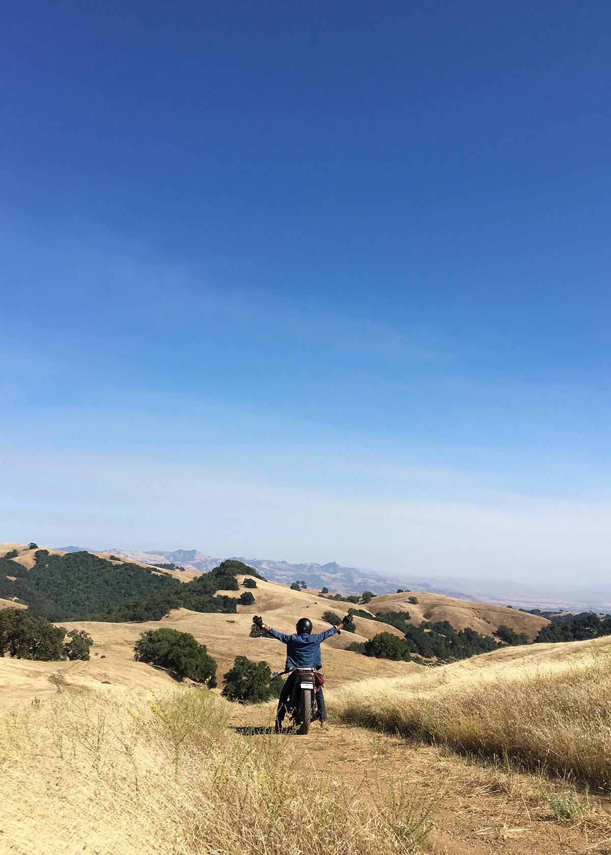 Niroshan Amarasiriwardena riding his Honda CB in the back country california